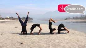 Yoga formation by four young yoga students.